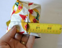 Snap shut coin purse made with measuring tape.
