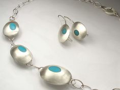 Pebbles in silver and resin