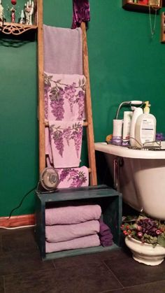 Old ladder and box for towels.  Chamber pot for flowers