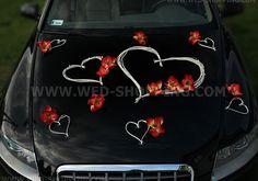 Décoration orchidées rouges et coeurs blancs voiture mariage