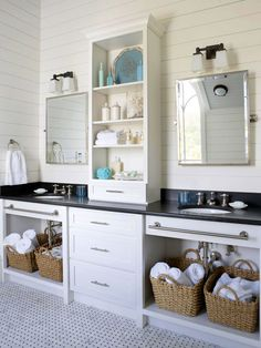 coastal bath with open shelving and drawers placed in the middle of the vanity.