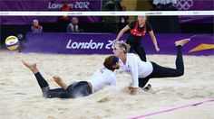 Kerri Walsh Jennings and Misty May-Treanor of the USA collide during the women's Beach Volleyball preliminary match between USA and Czech Republic on Day 3 of the London 2012 Olympic Games at Horse Guards Parade  http://www.london2012.com/photos/latestpictures.html#