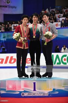 Nathan Chen of the USA (bronze), Yuzuru Hanyu of Japan (gold) and Keiji Tanaka of Japan (bronze) pose on the podium during the ISU Grand Prix of Figure Skating NHK Trophy on November 26, 2016 in Sapporo, Japan.