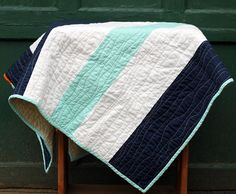 Very modern but love the simplicity and colors This modern baby quilt measures 34 W x 39 T.