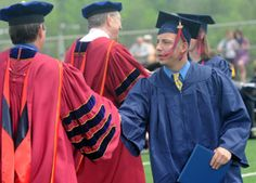 Jonathan Hawkins of Chambersburg receives his diploma during the Shippensburg University Undergraduate Commencement on Saturday, May 5, 2012. (Public Opinion/Ryan Blackwell)