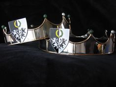 The second Lions Gate Baronial circlets. Nickel silver base with brass accents. The device is constructed out of Sterling Silver and enamelled with resin enamels. Nephrite Jade and Cultured Pearls top the circlet.