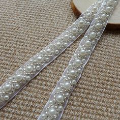 Hey, I found this really awesome Etsy listing at https://www.etsy.com/listing/186229596/beaded-lace-trim-ivory-pearl-beaded-trim