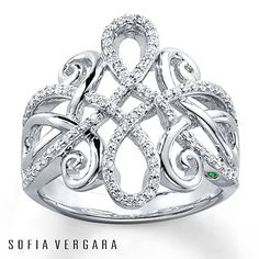 Ribbons of sterling silver twist and curl into an elegant design in this fantastic ring from SOFIA VERGARA. The ring is decorated in shimmering round diamonds, totaling 1/3 carat in weight. Diamond Total Carat Weight may range from .29 - .36 carats.