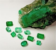 Emerald rough and faceted gem stones