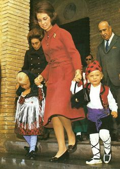 Queen Sophia of Spain with her two youngest children, Infanta Christina and Felipe, prince of Asturias in a spanish traditional costume