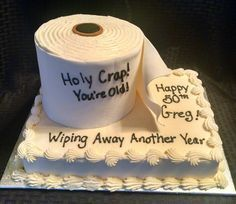 Funny toilet paper cake for a 50th birthday over the hill party. #50thBirthdayPartyIdeas #50thBirthday