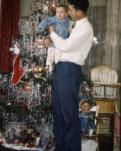 Christmas 1947 -- young father, probably a war veteran, look at the pride over his son, etc.
