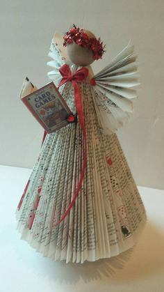 Custom Repurposed Book Angel Delivered from a book by the customer country librarian teacher reuse recycling repurposed books Book Christmas Tree, Paper Christmas Ornaments, Christmas Angels, Christmas Diy, Christmas Decorations, Old Book Crafts, Book Page Crafts, Paper Crafts, Handmade Christmas Crafts