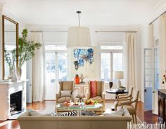 Such a nice mix of traditional and modern! The ceiling fixture and rug make this room very livable and not too formal.