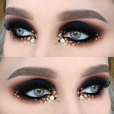 Gold flecks and black liner. I love this glitter placement and shaping of the eyes.