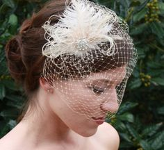 As Seen in Polka Dot Bride Champagne Birdcage Veil with Ostrich Feather Wedding Fascinator. $86.00, via Etsy.