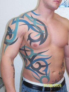 Tribal na plecach.brzuchu i ramieniu tatuaż - Nasze tatuaże