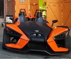 The Polaris Slingshot painted orange. Still looks pretty cool considering it has three wheels, but still a motorcycle.