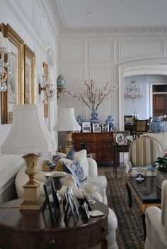 The Enchanted Home: blue and white décor, like the darker furniture and gold accessories