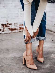 Chic blush heels with blue jeans.