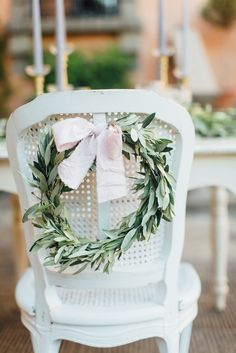 Wedding chair with olive branch - photo by OctaviaplusKlaus