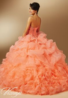 Coral Quinceanera Dress by Vizcaya Morilee designed by Madeline Gardner. Embroidery and Beading on Organza Princess Ball Gown. Matching Bolero Jacket included. Colors available: Coral, Bright Purple, Mint and White.