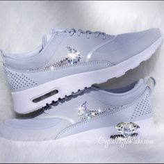 Nike Air Max Thea Made with Swarovski Crystals. Authentic Nike Thea's Made with Swarovski Crystals hand placed one by one. Gorgeous great light grey color with crystals that shine like diamonds  visit our website for more colors and style and follow us on social media CrystallizedKicks.com Nike Shoes Athletic Shoes