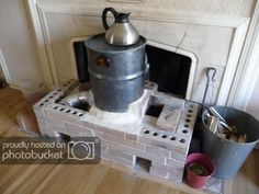 What is a rocket stove mass heater? What are the benefits of rocket mass heaters? What are possible disadvantages of having rocket mass heater? Building instructions and what do you need? Stove Heater, Stove Oven, Build A Rocket, Rocket Mass Heater, Thermal Mass, Cooking Stove, Rocket Stoves, Heating And Cooling, Heating Systems