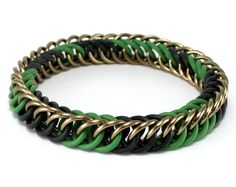 "Camouflage Stretch Chainmaille Bracelet- Handmade from high quality aluminum and rubber rings- Lightweight and durable, corrosion (rust) resistant - Stretchy, no clasp needed; comfortable to wear- Unique camouflage patternThe bracelet is approximately 3/8"" wide and 1/4"" thick."
