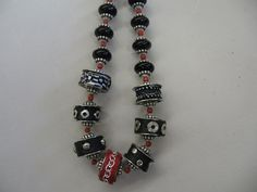 Necklace from metal sewing machine bobbins beads & polimer clay