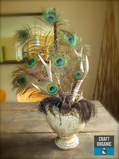 #Feather and #Antler arrangement instead of flowers.