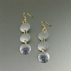 These super light-weight #handmade #aluminum Sand Dollar #earrings are guaranteed to turn heads. The hand-chased texturing is enhanced with a highly polished finish making them a work of art anyone can appreciate. #handmadeearrings $55