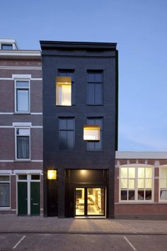 Great concept to leave the old windows in the facade and integrate new ones as a obvious second generation design. Old school meets new school! - Black Pearl House: a 100 year old, neglected Rotterdam house renovated by Studio. Minimalist Architecture, Contemporary Architecture, Interior Architecture, Rotterdam Architecture, Creative Architecture, Architecture Wallpaper, Design Exterior, Black Exterior, Black Building