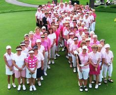 Rally for the Cure players assembled in a ribbon formation.