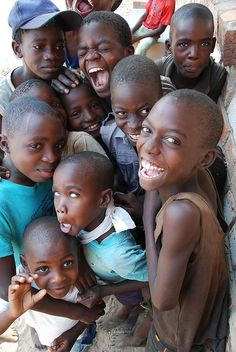 These kids have every reason in the world not to smile, yet they are.