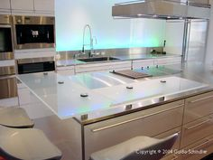 Stainless Steel countertops with floating glass bar