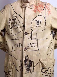 """FILE - This 2014 photo provided by Swann Auction Galleries shows a leather jacket decorated by Jean-Michel Basquiat and other personalities of New York City's 1980s underground art scene. Basquiat's contribution includes schematic drawings and the words """"breast"""" and """"corset"""". On Wednesday, Nov. 12, 2014, the jacket was sold to an online bidder for $9,100 during Swann's auction in New York. (AP Photo/Swann Auction Galleries, File)"""