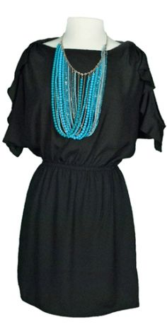 love everything about this. The black dress (obviously) with the 'statement' necklace, as my very fashionable college roommate would have called it! :D