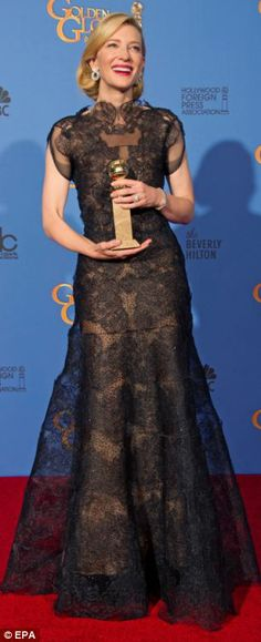 The mother-of-three holds her Golden Globe for Best Performance by an Actress in a Motion Picture at this years' awards