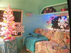 Not sure I want to have Christmas in a camper but I love the quilt and how feminine it looks!