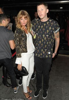 New wife Millie wears a white ensemble and an embroidered jacket at her husband's nightclub INK