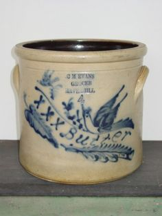 "Four gallon crock with cobalt decoration, stamped ""CM Evans Grocer Haverhill"" Dimensions: Ht. 11 1/4""  Date / Circa: c. 1860  Maker / Origin: New England"
