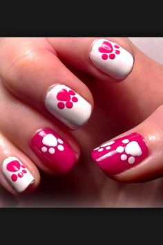 You can use a bobby pin if you don't have nail ball pins. Make a big white circle with bobby pin then smaller ones to make a dog print paw.