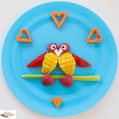 love birds plate.  My boys love to eat corn off the cob too much to ever do this, but cute bird idea