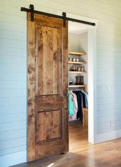 Luxury Country Farmhouse Closet. The Sliding Master Bedroom Closet Door Is  Made Of Knotty Alder