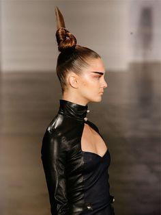 Weird hair, but true fashion. Stuck up b....!