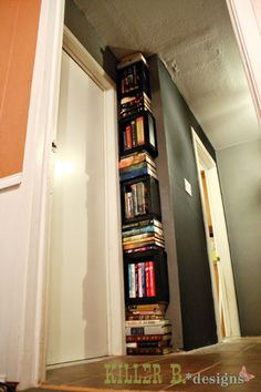 Creative Book Tower for Small Spaces. Craft shadow boxes, mount to wall, fill with books!