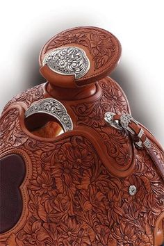 Beautiful tooled saddle (TCAA Traditional Cowboys Arts Association)