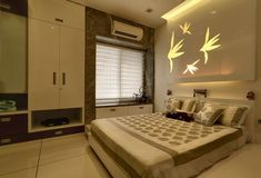 Contemporary Bedroom interiors designed by Hyderabad's leading interior designers, Finesse Interiors & Refurbishers Ent. visit: www.finesseinterior.com