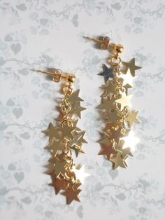 Stars earrings gold Long dangle with tiny sparkling by LilyandFern, €12.00